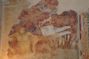Particolare degli affreschi del XV sec. di San Filippo e San Giacomo di Ello: un diavolo scorta l'anima del ladrone impenitente.